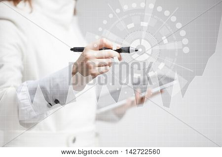 Female hand holding stylus and working with graph chart. Future technologies for busines, stock market concept.