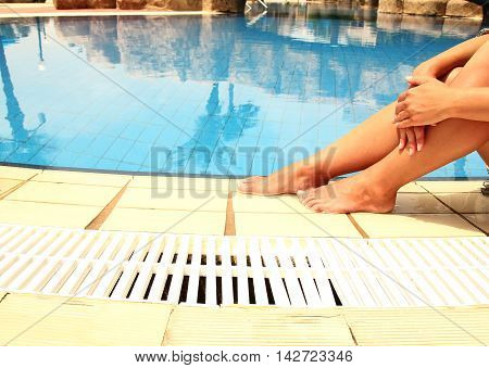 a nice female legs in the pool water