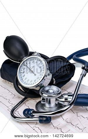 Medical stethoscope and manometer on cardiogram chart isolated closeup with clipping path