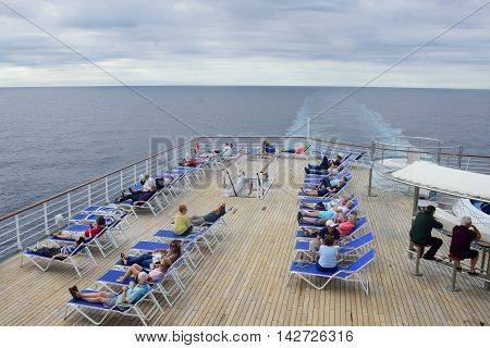 North Sea England United Kingdom - July 28 2016: Passengers relaxing on deck of cruise ship out in open sea