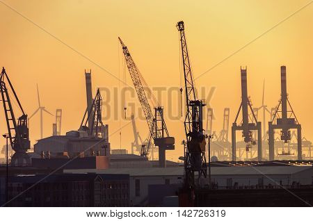 Port of Hamburg on the river Elbe in Germany in the early morning. It is the third largest in Europe and the most popular attraction in the city