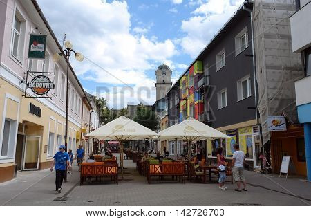 POPRAD SLOVAKIA - JULY 08.2016: Small street and umbrellas in Poprad town High Tatras Slovakia.
