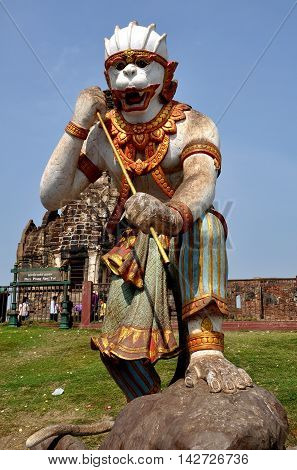 Lopburi Thailand - December 29 2013: Statue of a monkey warrior stands at the entrance to historic Khmer style Wat Phra Prang Sam Yotn