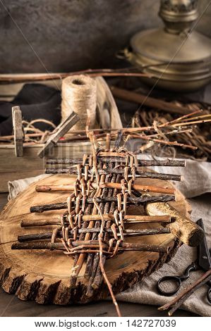 Vne stems and other items for basket weaving on table