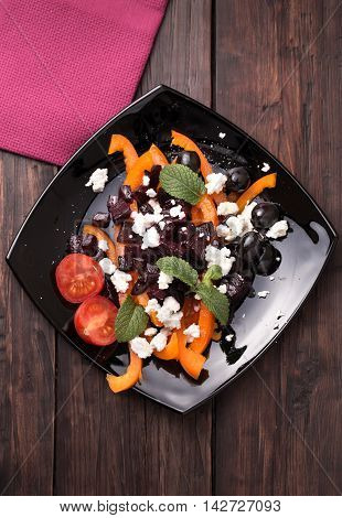 Fresh beetroot salad with sweet pepper, feta cheese and olives