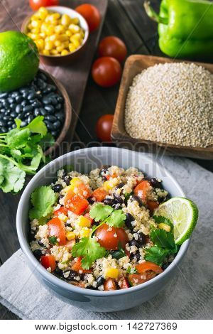 Black bean quinoa salad and cooking ingredients. Toned