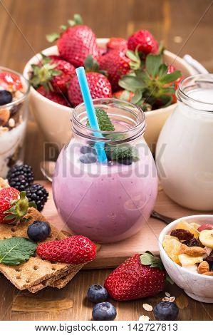 Blueberry yogurt and other granola ingredients still-life