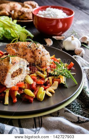 Baked Chicken Breast Stuffed With Cheese, Tomato And Basil With Rice And Steamed Vegetable Salad