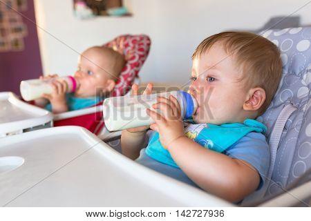 Baby boy drinking milk from the bottle