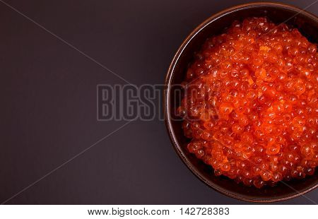 Bowl of red caviar top view with copyspace