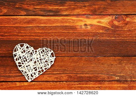 romantic tender heart on a wooden background