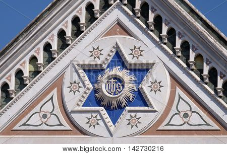 FLORENCE, ITALY - JUNE 05: IHS sign, Basilica di Santa Croce (Basilica of the Holy Cross) - famous Franciscan church in Florence, Italy, on June 05, 2015
