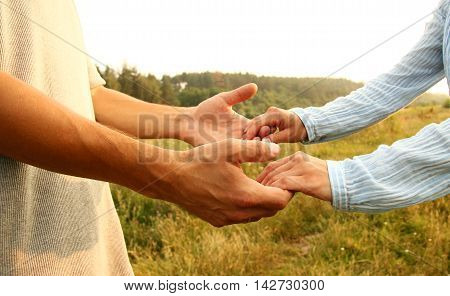 two hands couple of love on nature