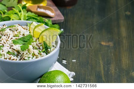 Bowl of cilantro lime basmati rice from left side of wooden table