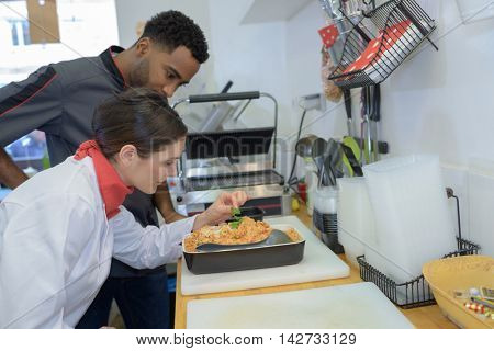 team of cooks working in the kitchen