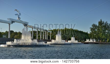 Tashkent, Uzbekistan - July 02, 2014: The large fountain in front of the main square in Tashkent. Square (Mustaqillik Maydoni) is the Central square of the capital where celebrations and military parades in the days of special events and public holidays.