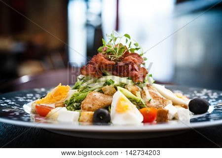 Caesar salad with chicken and greens on a plate