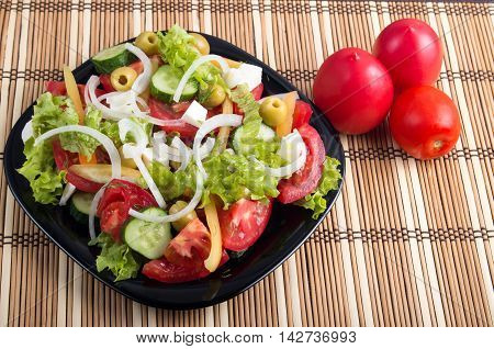 Useful And Natural Vegetable Salad Of Tomato, Cucumber, Olives