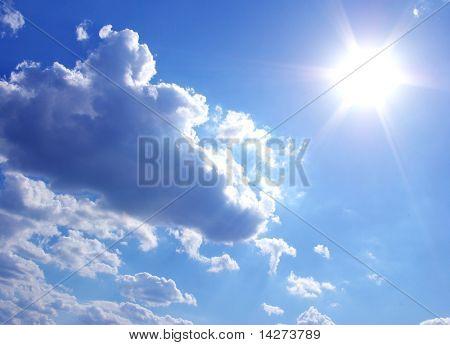 sun in a blue cloudy sky