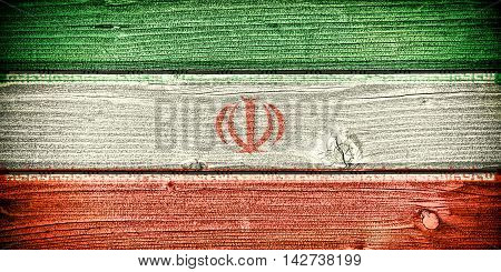 flag of Iran painted on old grungy wooden background