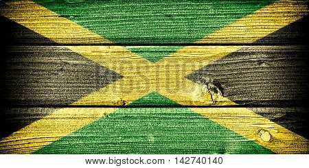Flag of Jamaica painted on old grungy wooden background