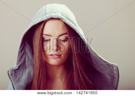 Portrait Of Pensive Teenager Girl In Hood.