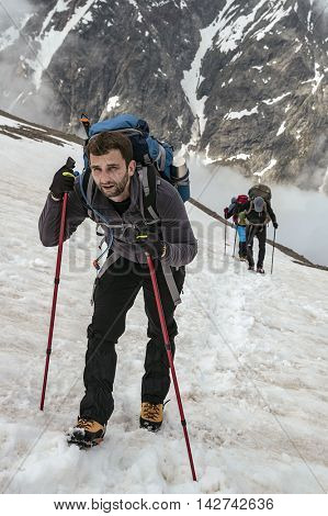 Mountaineer on Mont Blanc mountain slope. French side of the alps.