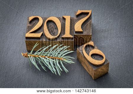 new year 2017 replacing the old year 2016 - letterpress wood type printing blocks on a slate stone