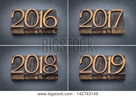 year 2016, 2017, 2018 and 2019 set - text in letterpress wood type against gray slate stone