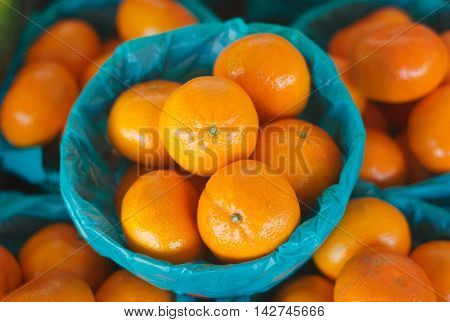 orange clementines in basket at the market crop view