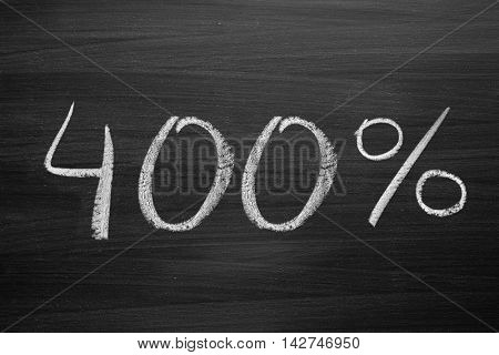 400-percent title written with a chalk on the blackboard