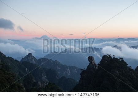Mountain landscape on san qing shan in China with a rock that looks like a praying woman