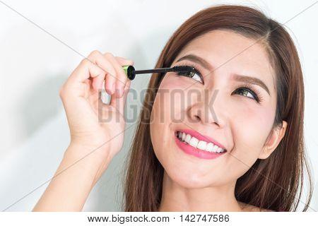 Mascara Applying Closeup, Long Lashes. Mascara Brush. Eyelashes Extensions. Make-up For Blue Eyes. E