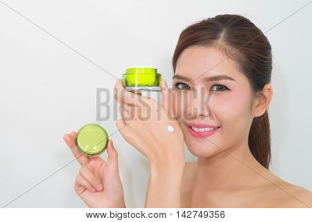 Beautiful Asian Woman Using A Natural Skin Care Product, Moisturizer Or Lotion. Isolated With Clippi