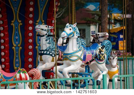 the carousel horses in the recreation park