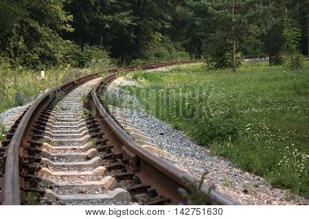 rails and sleepers on the railway track turn right
