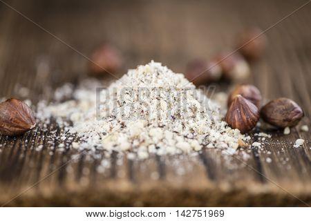 Hazelnuts (grounded) On Wooden Background