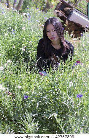 Portarit Thai woman with purple flower garden