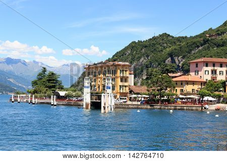 Ferry Dock In Village Varenna At Lake Como With Mountains In Lombardy, Italy