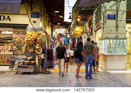ATHENS, GREECE - AUGUST 14, 2016: People in the flea market of the old town of Plaka on August 14, 2016.