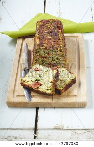 Sliced Veal cake on wooden cutting board with tablecloth