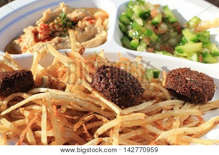 Venice boardwalk poke and pucks with fried potatoes and mashed vegetables
