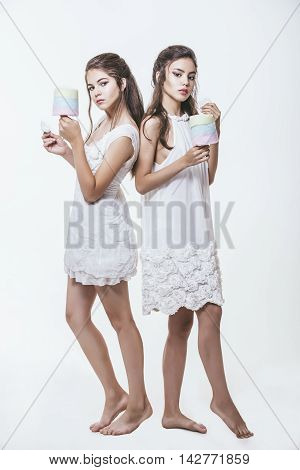 Beautiful Young Girls In White Dresses With Colorful Cotton Candy