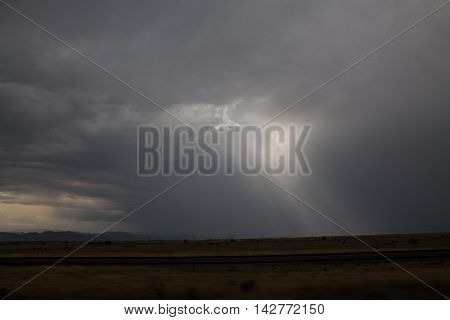 Sun rays peeking through during a front range storm