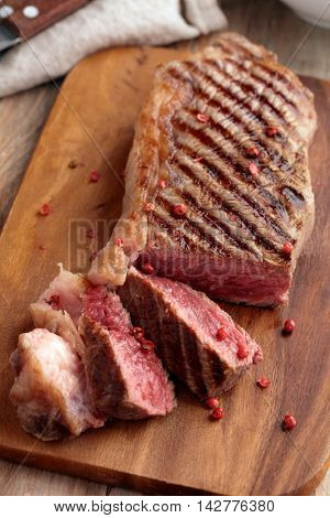 Marbled beef steak on a wooden cutting board