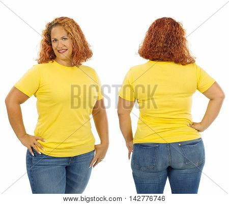 Photo of a woman posing with a blank yellow t-shirt ready for your artwork or design.
