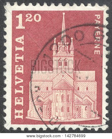 MOSCOW RUSSIA - CIRCA JUNE 2016: a post stamp printed in SWITZERLAND shows Abbey Church Payerne circa 1968