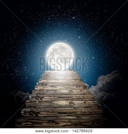 staircase rises to the moon in the night sky. Elements of this image furnished by NASA