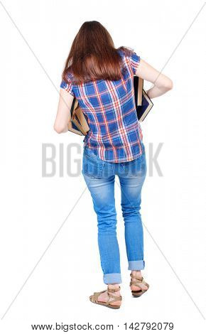Girl comes with  stack of books. back side view. Rear view people collection.  backside view of person.  Isolated over white background. Girl in a plaid shirt is trying to keep falling out of the book