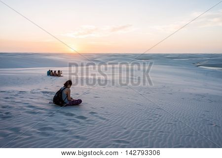Lencois Maranhenses Brazil July 13 2016 - Tourists are saying goodbye to the sun from Sand dunes with blue and green lagoons in Lencois Maranhenses National Park